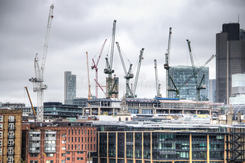 View on London skyline from the Thames river, London, UK. London skyline with modern buildings and cranes seen from the river Thames in London, the capital of stock images