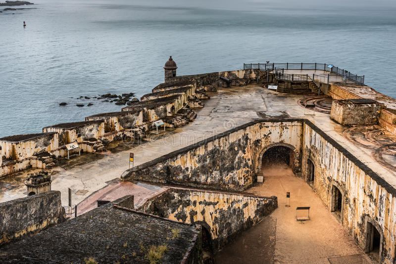 View looking down of Castillo San Felipe del Morro corner. View looking down on the corner of the Castillo San Felipe del Morro rain soaked walkways and walls stock image