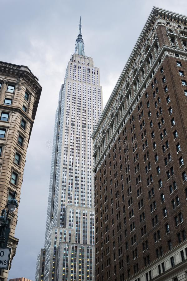 View looking up of the Empire State Building, seen from Herald Square, ,  New York City, United States.  stock photography
