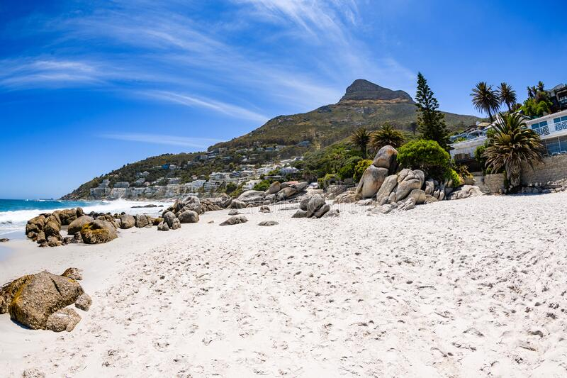 A view looking up at table mountain from the beautiful white sand beach of clifton in the capetown area of south africa.4 stock photography