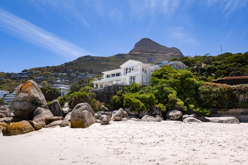 A view looking up at table mountain from the beautiful white sand beach of clifton in the capetown area of south africa.6 royalty free stock photo