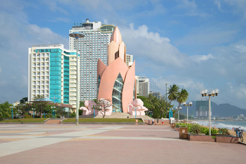 A view of the Lotus Tower in the center of Nha Trang in the cloudy afternoon. NHA TRANG, VIETNAM - DECEMBER 30, 2015: A view of the Lotus Tower in the center of stock photo