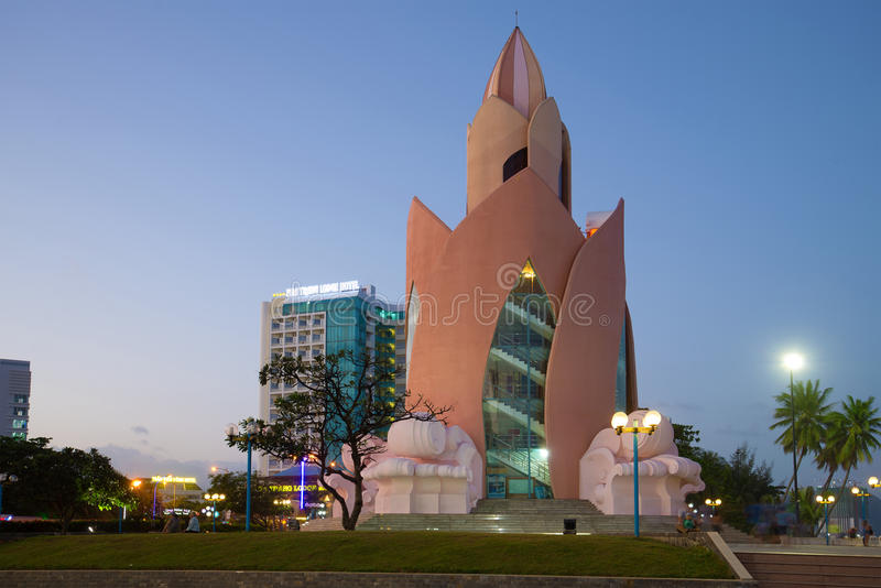 A view of the Lotus tower in evening twilight. Vietnam. NHA TRANG, VIETNAM - DECEMBER 29, 2015: A view of the Lotus tower in evening twilight royalty free stock photo