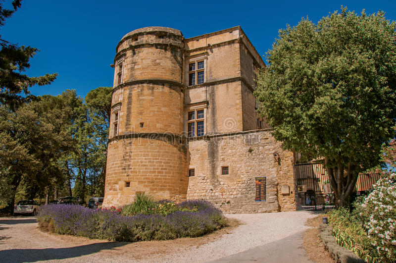 View of the Lourmarin castle with lavender bush in front, near Lourmarin. View of the Lourmarin castle with lavender bush in front, near the village of royalty free stock photo