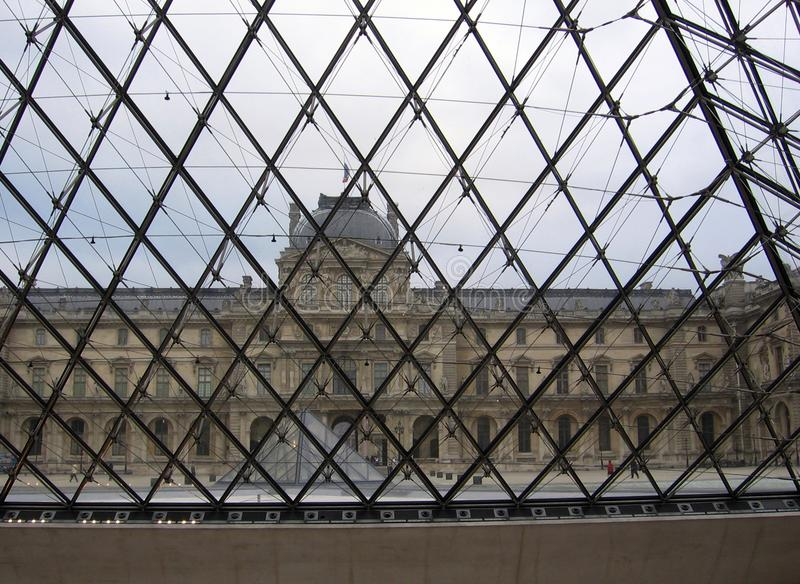View of the Louvre Museum from inside the Pyramid of the Paris France Museum stock photos