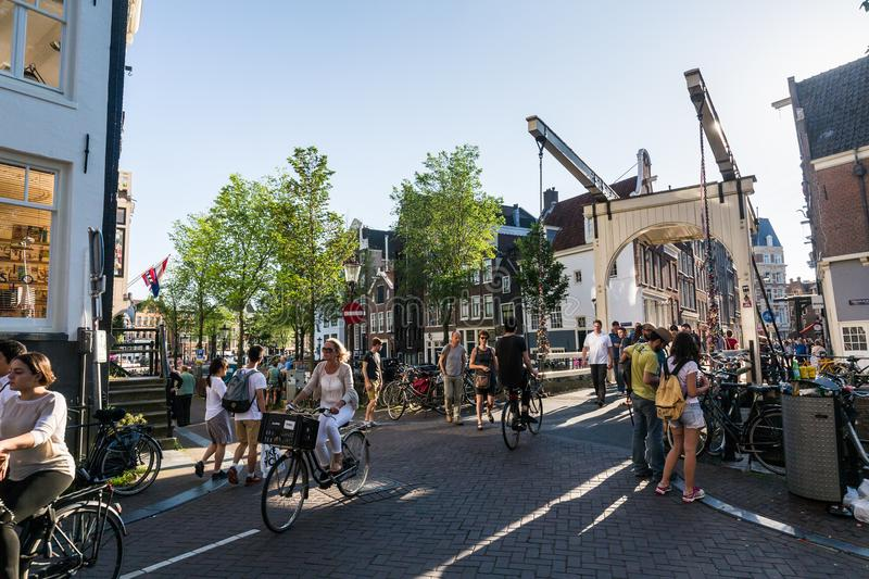 View from the Love Lock Bridge Bridge in the old town part of Am. AMSTERDAM, NETHERLANDS - MAY 26, 2017: View from the Love Lock Bridge Bridge in the old town royalty free stock images