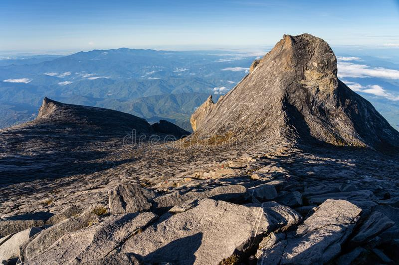 View from Low`s peak summit of Kinabalu mountain massif in Borneo island, Sabah, Malaysia stock images