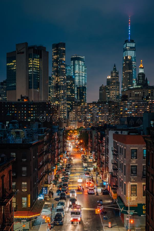 View of the Lower East Side and Financial District at night, from the Manhattan Bridge in New York City stock photography