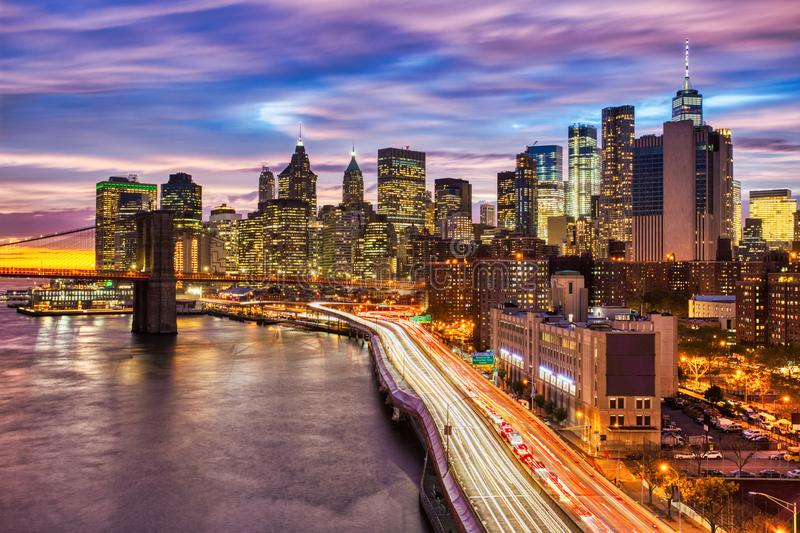 View of Lower Manhattan with Brooklyn Bridge at Sunset, New York City. USA stock image