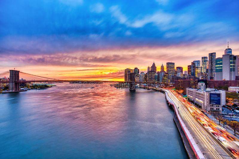 View of Lower Manhattan with Brooklyn Bridge at Sunset, New York City stock images
