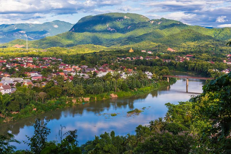 View of Luang Prabang and Nam Khan river in Laos with beautiful. Sunset light bathing the background mountains royalty free stock photos