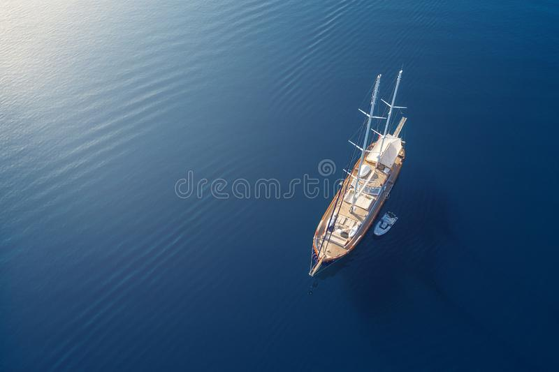 View on the luxury yacht in Croatia. Blue sea water background from air. Summer seascape from air. royalty free stock photography