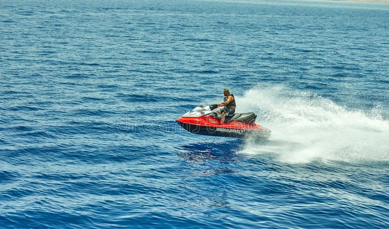 View from the luxury yacht to the Red Sea, jumping and riding a jet ski. Eilat, Israel - July 13, 2019: View from the luxury yacht to the Red Sea, jumping and royalty free stock photo