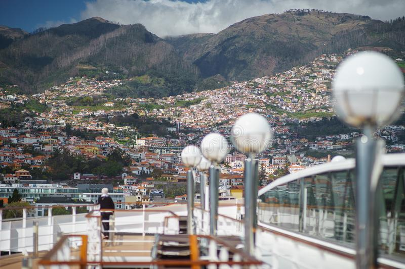 View of Madeira Island from the cruise ship with deck and woman on it foregraund royalty free stock photo