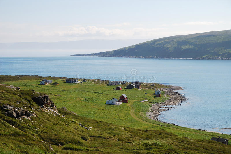View of Mageroya with small fishing village near blue fjord. stock photo