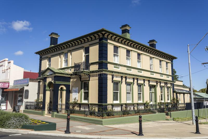 Glen Innes Old Buildings at the Turn of the Century. View of the magnificent 1874 Georgian palace, today working as a luxury guest house, and its iron palisade stock image
