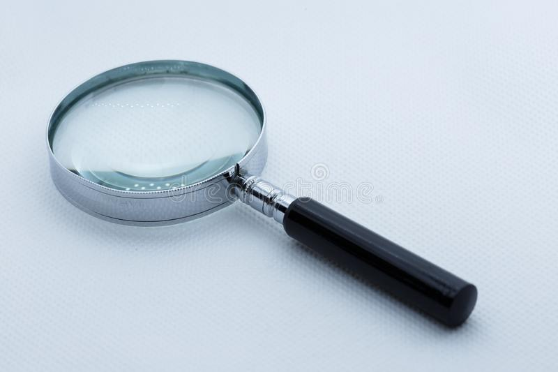 View of magnifying glass, white background.  royalty free stock image