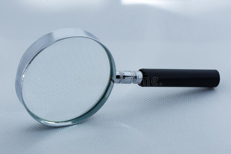 View of magnifying glass, white background royalty free stock photo