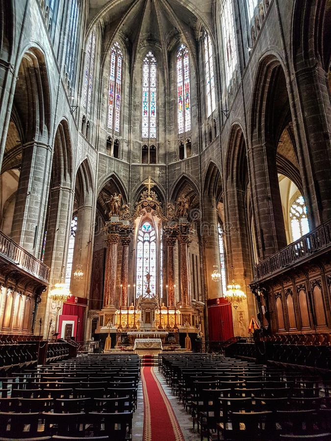 Main altar of the Cathedral of Narbonne. View of the main altar of the cathedral of Narbona and great lamp royalty free stock image