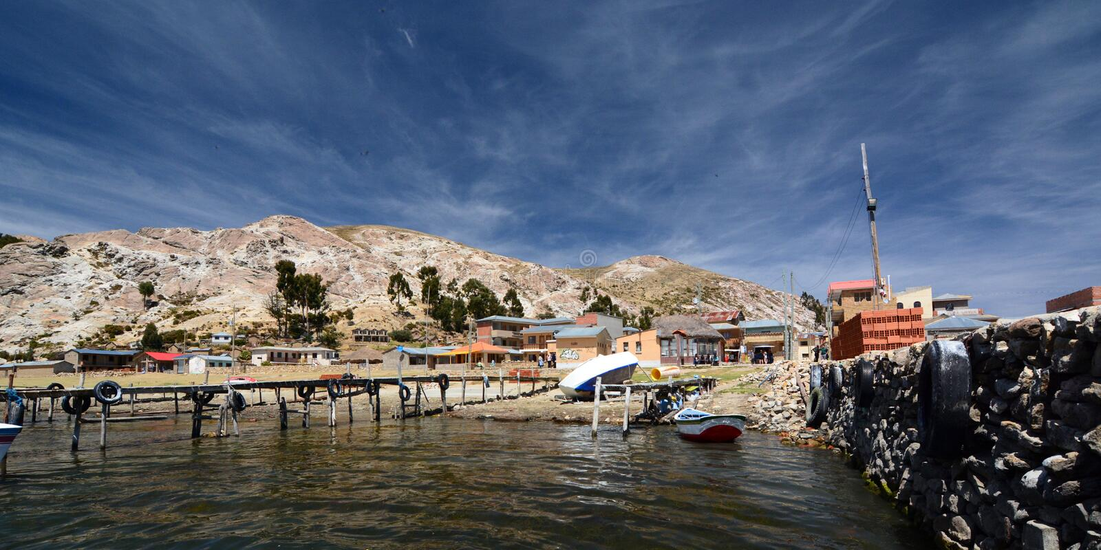 View from the main pier. Comunidad Challapampa. Isla del Sol. Lake Titicaca. Bolivia. Lake Titicaca is a large, deep lake in the Andes on the border of Peru and stock image