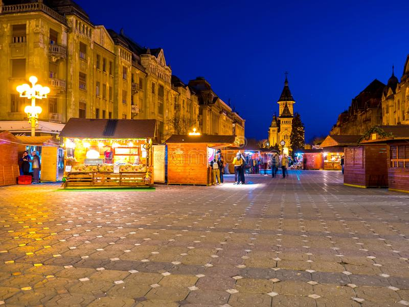 View on the main square in Timisoara at night. TIMISOARA, ROMANIA - OCTOBER 15: View on the Main Square  as People pass by at the Orthodox Cathedral in the royalty free stock photo