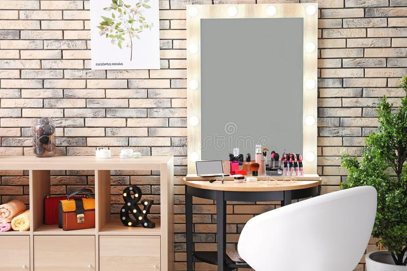 View of makeup room with decorative cosmetics. And tools on dressing table royalty free stock photos
