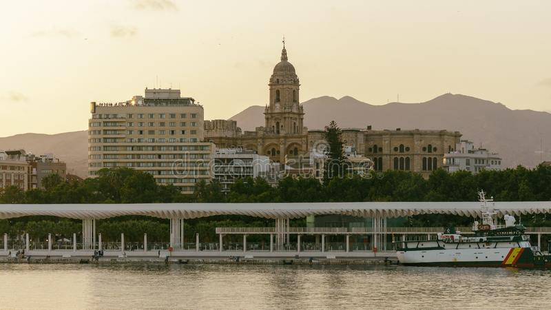 Malaga cathedral at sunset. View of Malaga Cathedral from the harbor at sunset royalty free stock photo