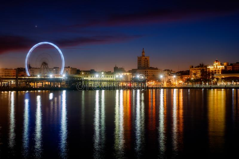 View of Malaga city and Ferris wheel from harbour, Malaga, Spain royalty free stock photography
