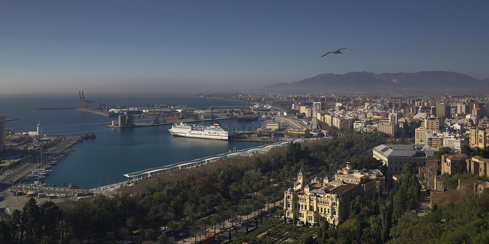 View of the Malaga Harbour. A top view of Malaga with the harbour and mountains in the background stock image