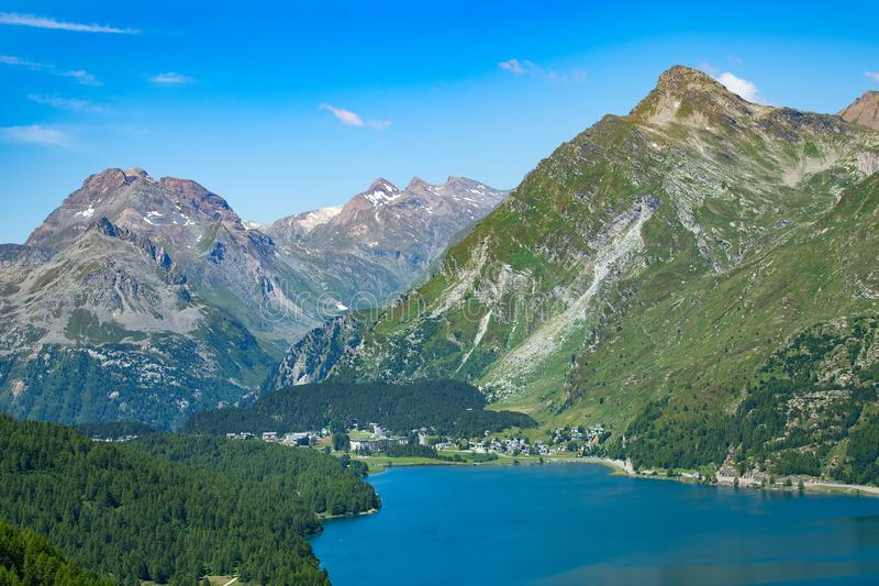 View of the Maloja pass in valley Engadine Switzerland. Beginning of the Inn River stock images