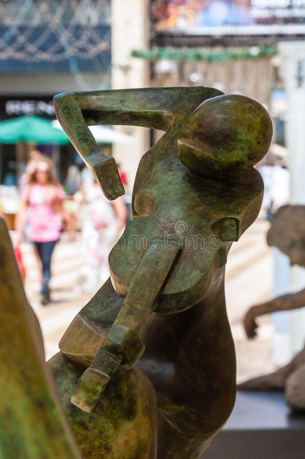 View on Mamilla road through street art bronze sculpture of woman violinist playing on violin stock photos