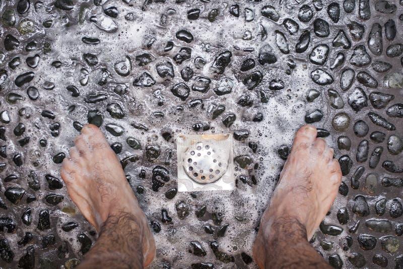 Shower on black stones royalty free stock photos