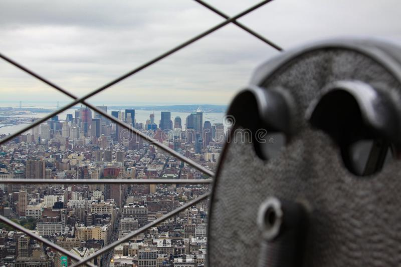 View Manhattan. Historical binoculars with blur and view of Downton New York royalty free stock photo
