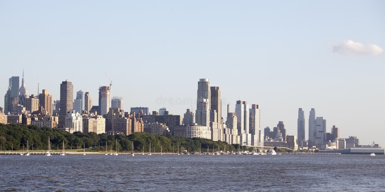 View at Manhattan from the Hudson river in the afternoon sun - New York City. View from the Hudson riverat the skyscrapers of Manhattan in the afternoon sun royalty free stock image