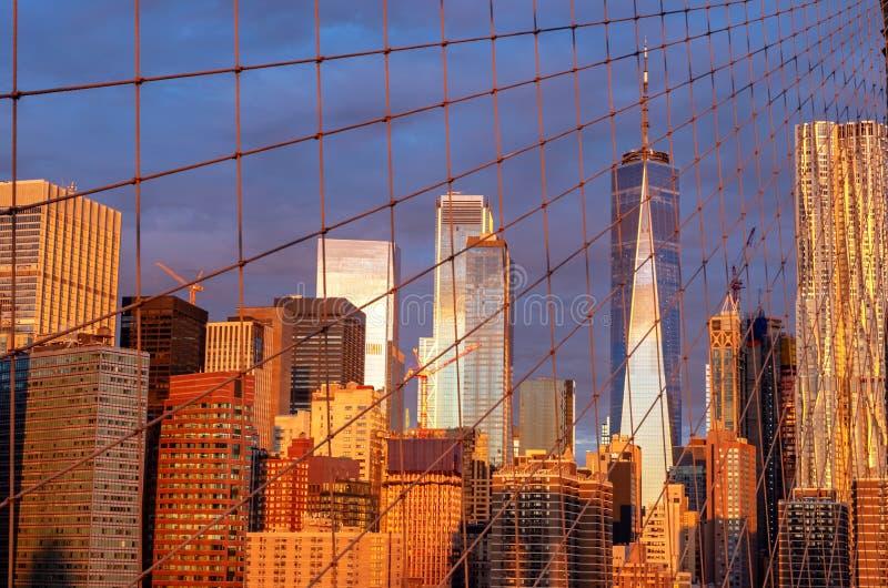 Manhattan Skyline from Brooklyn Bridge during sunrise in New York. USA stock photo