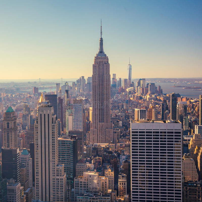 View of Manhattan skyline and skyscrapers at sunrise, New York C. Aerial view of Manhattan skyline and skyscrapers at sunrise, New York City, USA stock photos