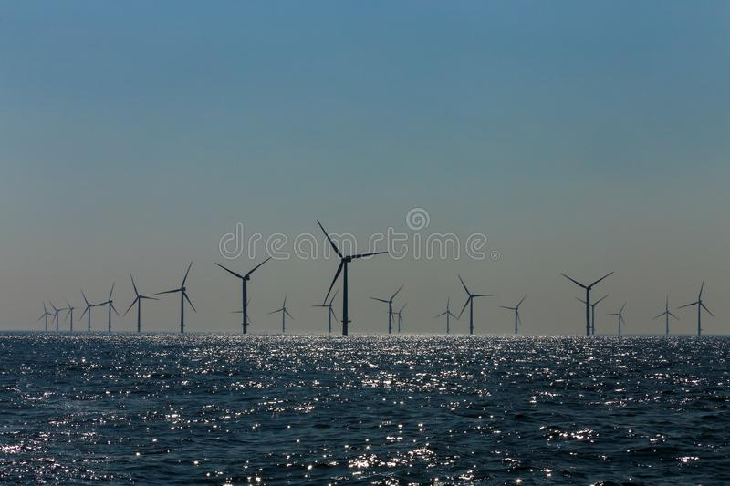 View of the offshore windmills of Rampion windfarm off the coast of Brighton, Sussex, UK. View of the many windmill out of the coast of Rampion windfarm off the royalty free stock images