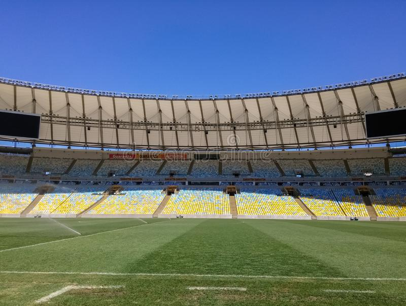 View of the Maracana Stadium from the soccer field with bright green grass stock photo