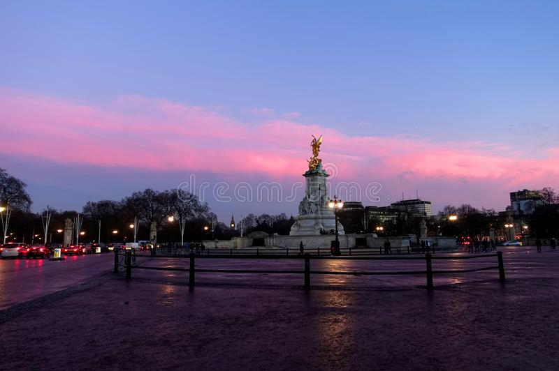 Queen Victoria Memorial. View of the marble Queen Victoria Memorial located in front of Buckingham Palace during a beautiful winter sunset in London. The statues stock images