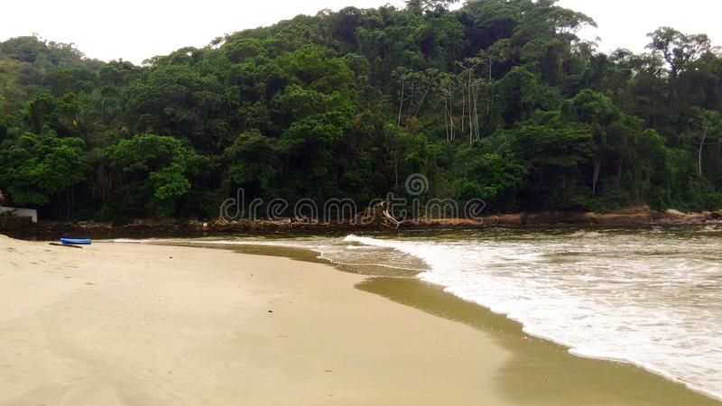 Beach with waves and golden light. View of Maresias beach in Sao Sebastiao, Brazil. It is one of the most appreciated refuges of the north coast of Sao Sebastiao stock photo