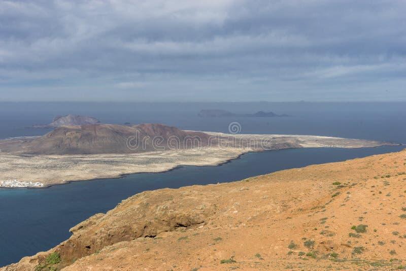 Graciosa Island, Canary Island. View from The Maridor del Rio on Graciosa Island and volcano , Lanzarote island. Canary Islands, Spain royalty free stock photography