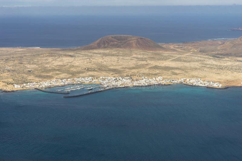 Graciosa Island, Canary Island. View from The Maridor del Rio on Graciosa Island and volcano , Lanzarote island. Canary Islands, Spain royalty free stock photo