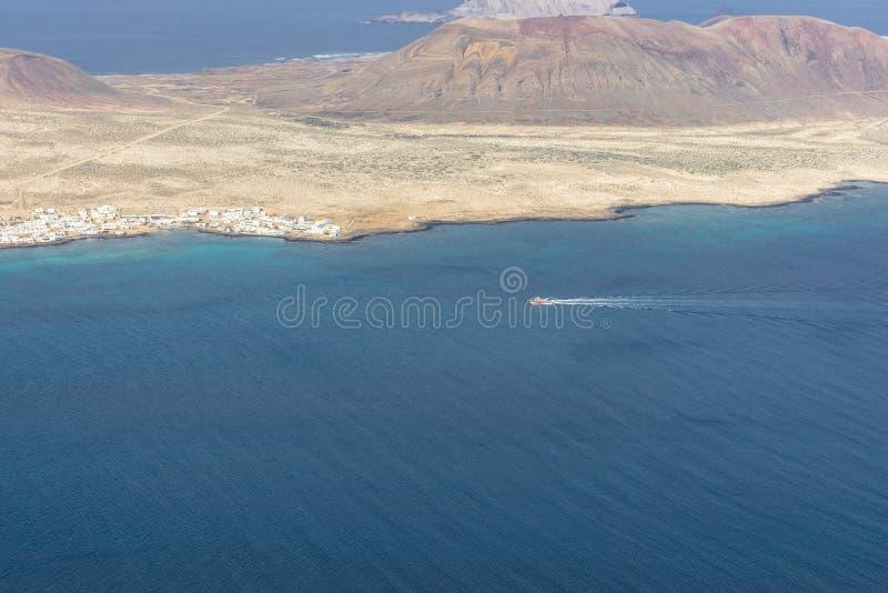 Graciosa Island, Canary Island. View from The Maridor del Rio on Graciosa Island and volcano , Lanzarote island. Canary Islands, Spain stock image