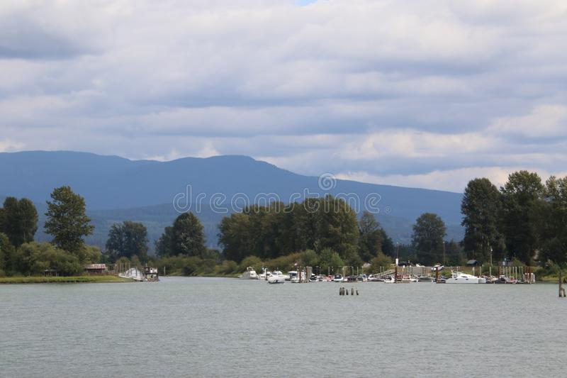 A view of a marina as seen from across the water royalty free stock image