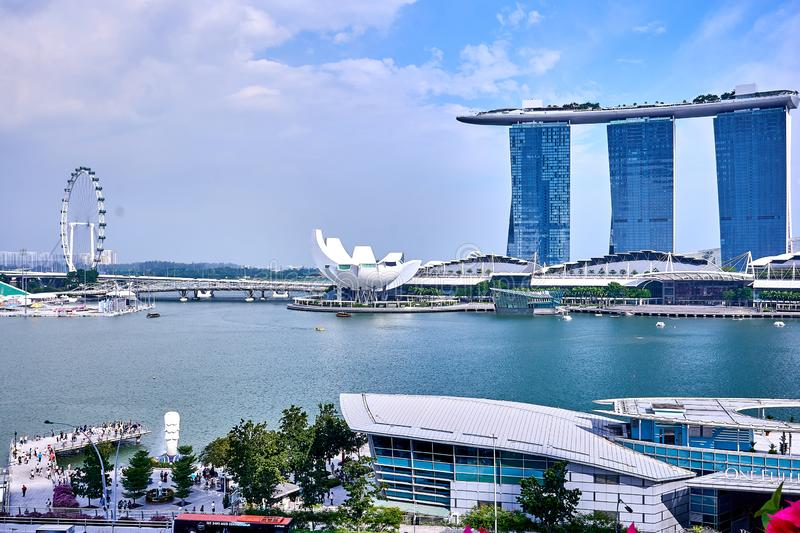 View of Marina Bay with the famous Singapore Flyer and the Merlion at the Clarke Quay. A view of Marina Bay with the famous Singapore Flyer and the Merlion at royalty free stock images