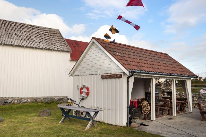 View of the marina house Naustklakken of the village of Dyrnes at Smola island, Norway. Dyrnes, Smola, Norway - August 30th, 2018: View of the marina house stock image