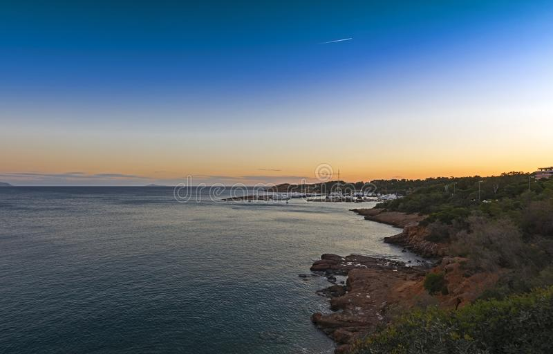 Marina of Vouliagmeni, Athens - Greece. View of the Marina of Vouliagmeni at the sunset, located at the southwestern of Athens, Greece. Vouliagmeni is among the stock images