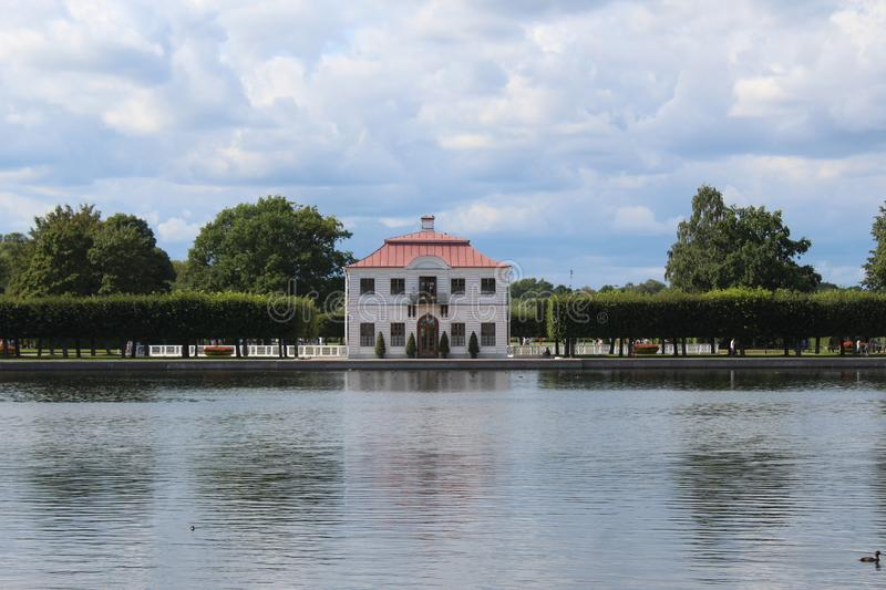 View of the Marley Palace and the pond in front of him in the Lower Park in Peterhof royalty free stock image