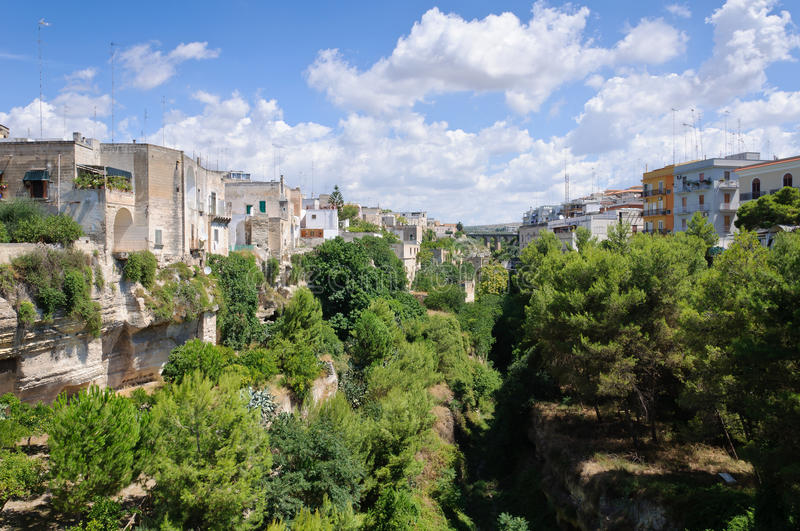 View of Massafra (Italy). View of the town of Massafra built on rocks in southern Italy stock image