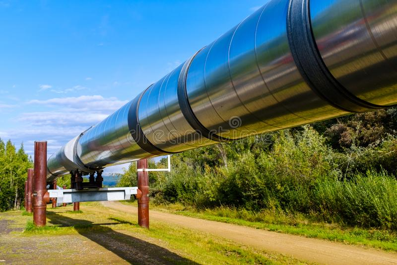 Trans-Alaska Pipeline System in Alaskan wilderness. View of the massive Trans-Alaska Pipeline System designed to move crude oil from the Prudhoe Bay all the way stock images
